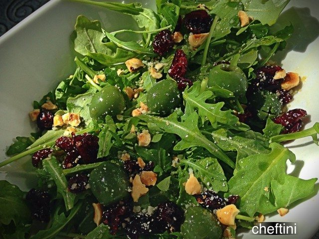 Arugula Salad with Hazelnuts, Craisins, and Castelvetrano Olives