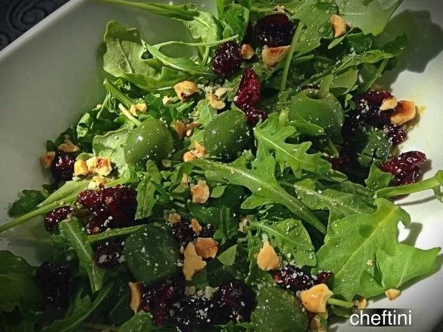 Arugula Salad with Hazelnuts, Craisins, and Castelvetrano Olives