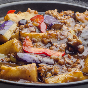 Stewed eggplant, ground pork and rice noodle roll in casserole
