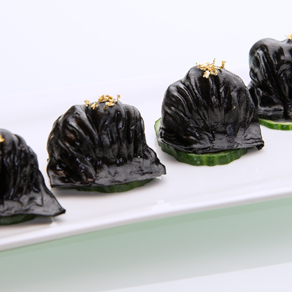 Steamed cuttlefish ink shrimp dumplings