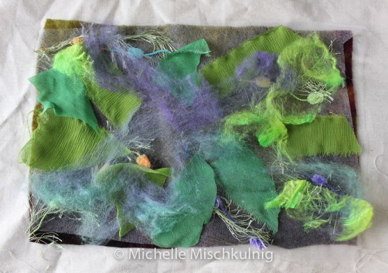 I place a layer of fusible web on top of my background fabric and then add scraps of interesting fabric and yarns. This is fused together by using a dry hot iron.