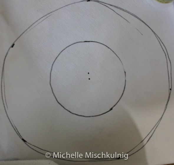 Then mark this the length for the center to the edged form the center of your original tracing .