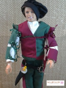 Miniature sword, sheath, and belt tutorials can be found at ChellyWood.com along with the free patterns to sew this costume for Ken dolls.