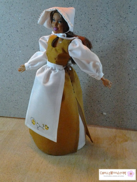 Barbie doll dressed in a medieval maid's costume