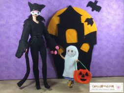 """Visit ChellyWood.com for free, printable sewing patterns for dolls of many shapes and sizes. Image shows a Made-to-Move Barbie wearing a Cat costume and a Polly Pocket wearing a ghost costume. Both costumes are hand-sewn. The Polly Pocket doll carries a jack-o-lantern, and the two dolls stand before a felt haunted house with a full moon rising behind it. The ground at their feet is sandy. Overlay says, """"ChellyWood.com: free printable sewing patterns for dolls of many shapes and sizes."""""""