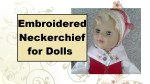 """The image shows an 18"""" (eighteen inch) doll wearing a traditional embroidered neckerchief in the style of 17th century Sweden."""