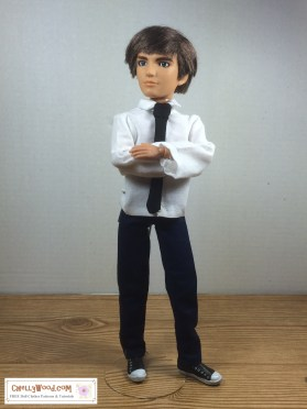 Image of Spin Master Liv Doll Jake wearing dress shirt, dress pants, and black tie. His arms are crossed. His black Vans-style sneakers clash slightly with his dressy attire.