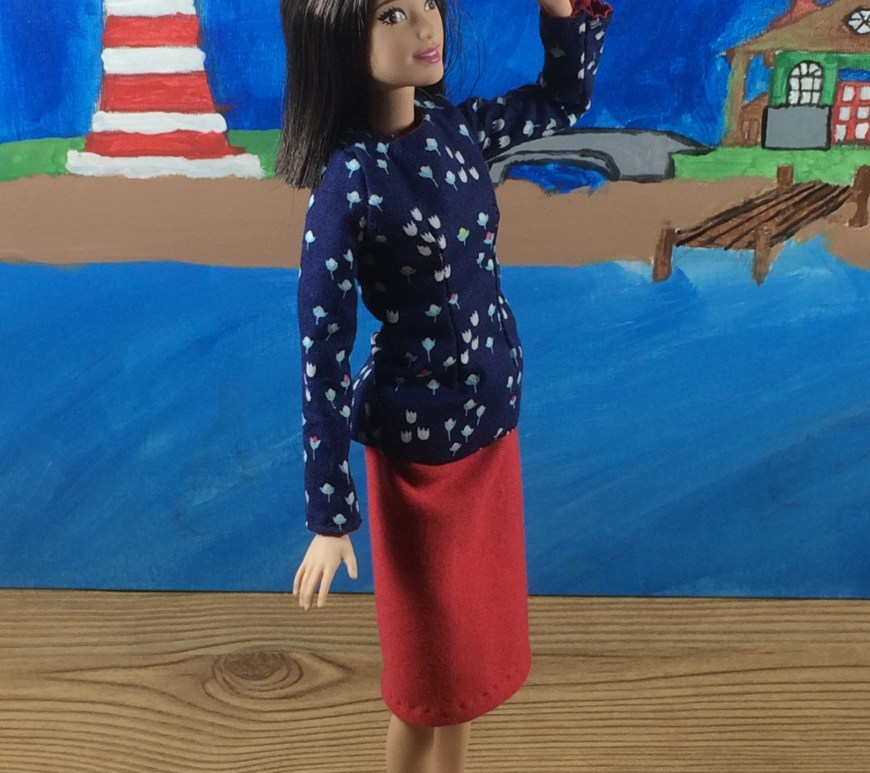 "Image of Mattel's tall Barbie, wearing a hand-made shirt and hand-made pencil skirt. The doll stands on a wooden platform overlooking a body of water. A painted lighthouse is behind her, along with a pier. The overlay says, ""ChellyWood.com: Free doll clothes patterns and tutorials."""