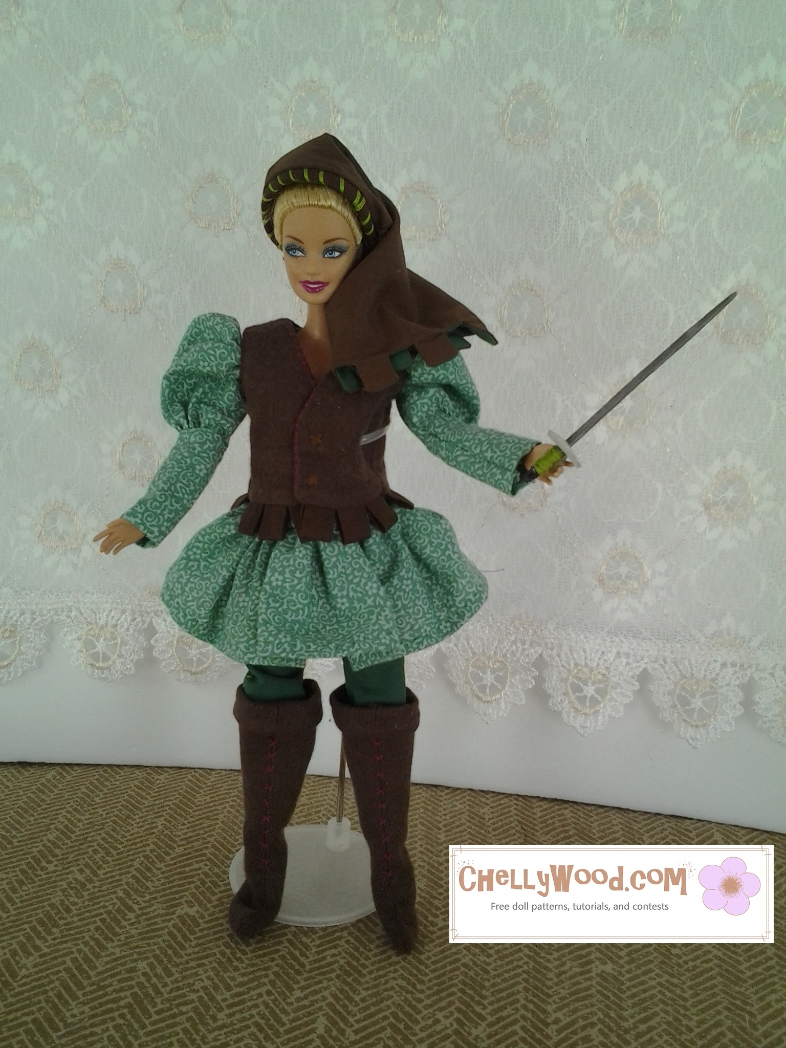 Here we see a Barbie dressed in Renaissance garb and wielding a sword. Her hat is a headband with a cotton frame draping down over her head and shoulder. She has a puff-sleeve tunic with skirting, and over the top of that, her doublet vest has squared edging below the waist. She wears embroidered trousers and knee-high flannel boots.