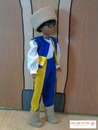 """Visit ChellyWood.com for free, printable sewing patterns to fit dolls of many shapes and sizes. Images shows 8-inch Hasbro World of Love """"Soul"""" doll wearing a renaissance costume, including a bi-colored pair of pants, a bi-colored vest, a white long-sleeved shirt, flannel boots, and a flannel hat. She is dressed to play the part of """"Benvolio"""" in Shakespeare's Romeo and Juliet. Behind her is a wall that has been painted to look like arched doorways in a Renaissance setting. These doll clothes patterns are free and printable on Chelly Wood dot com, and video tutorials are available for free as well. The patterns fit most 8"""" fashion dolls, like Stacie, Breyer dolls, and 8"""" dollhouse dolls."""