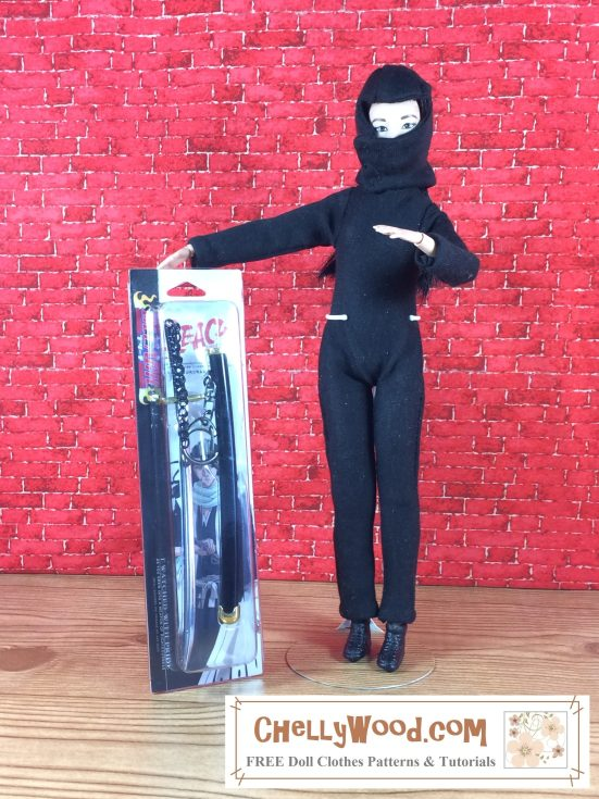 "Image shows Made-to-Move Barbie wearing a handmade Ninja costume complete with body suit, mask, and black shoes. She's holding a packaged ninja-style sword. Overlay says, ""ChellyWood.com: free printable sewing patterns for dolls of many shapes and sizes."""