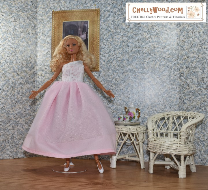 """Please visit ChellyWood.com for FREE printable sewing patterns for dolls of many shapes and sizes. Image shows a Made-to-Move Barbie wearing a hand-made quinceañera style ball gown with a lacy one-shoulder bodice. The doll stands in a 1:6 scale room complete with a painting on the wall, a wicker table, and a wicker chair. The wall paper has a speckled look to it. The floor of the doll's diorama looks like hard wood. Atop the wicker table is a porcelain tea set in 1:6 scale, with Barbie-pink flowers decorating it. The handles of the cups and teapot look like they are golden. The made-to-move Barbie poses with one leg extended and her toes pointed like a ballerina. Her arms are open wide, welcoming the viewer into her Barbie doll house. The overlay says, """"ChellyWood.com"""" and below that, it says, """"FREE printable sewing patterns for dolls of many shapes and sizes."""""""