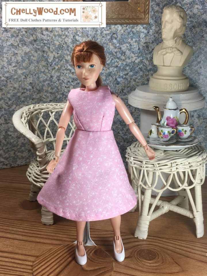 """Click here for all the patterns and tutorials you'll need to make this dress: https: https://wp.me/p1LmCj-GOj Image shows 8"""" Breyer Rider doll wearing an handmade A-line dress and standing in a 1:6 scale diorama that shows the bust of a musician, a classical painting, and is decorated with a wicker table and chair. On the table is a 1:6 scale porcelain tea set for little dolls. The 8"""" Breyer Rider doll wears a dress that has been sewn by hand. Overlay offers the sewing tutorials and free doll clothes patterns website: ChellyWood.com and states that this website has free doll clothes patterns and tutorials for dolls of many shapes and sizes."""