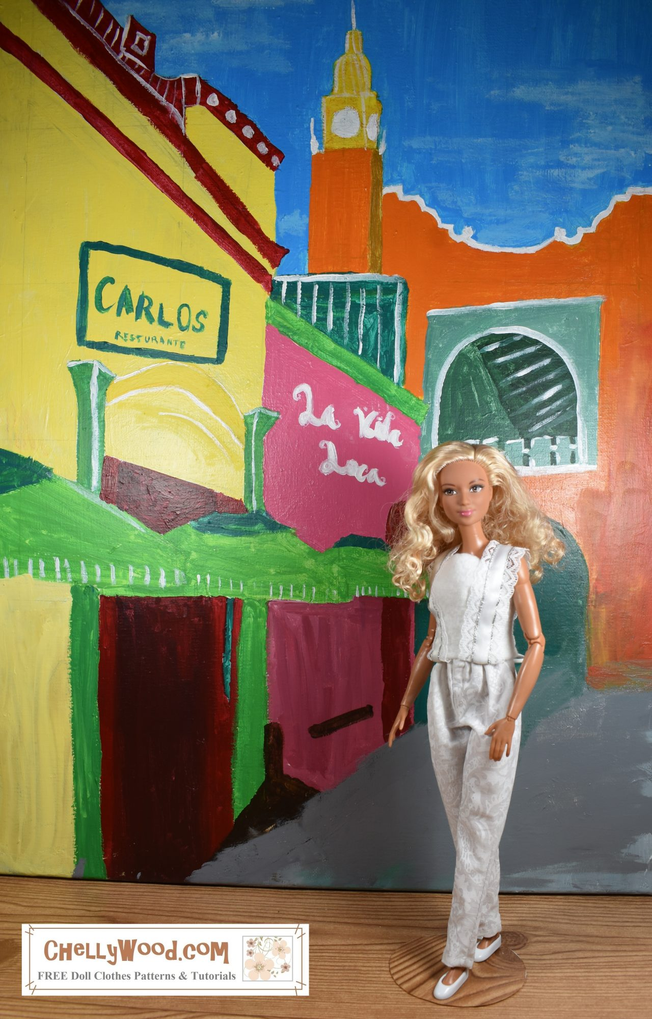 The image shows a Made to Move Barbie wearing a pair of puffy-top pants and a felt summer shirt that has lace straps and lace embellishments down the front (and back) of the shirt). The doll stands in a Caribbean-style painted backdrop.