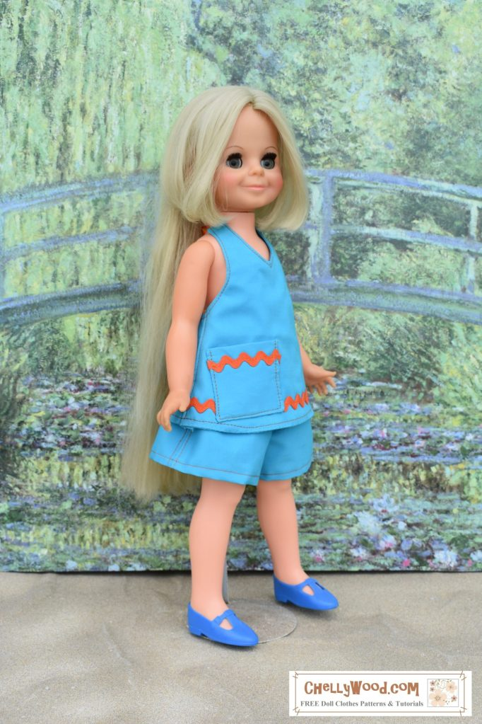 The image shows a vintage Velvet doll wearing a blue halter top with rickrack trim and shorts. To access the free printable PDF sewing patterns and tutorial videos for making this outfit, please click on the link in the caption. This is a very versatile pattern, and it will fit dolls this size, as well as dolls both bigger and smaller than this.