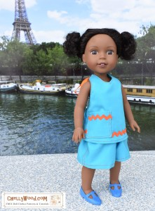 The image shows a 15-inch Wellie Wisher doll wearing a pair of elastic waist shorts with a halter top. The doll clothes are trimmed in orange rickrack (zigzag) trim. If you'd like to make the doll clothing shown here, please click on the link in the caption. It will take you to a place where you can download the doll clothes patterns for free. Please note that this pattern will fit lots of different dolls, as it's one of my most versatile patterns.