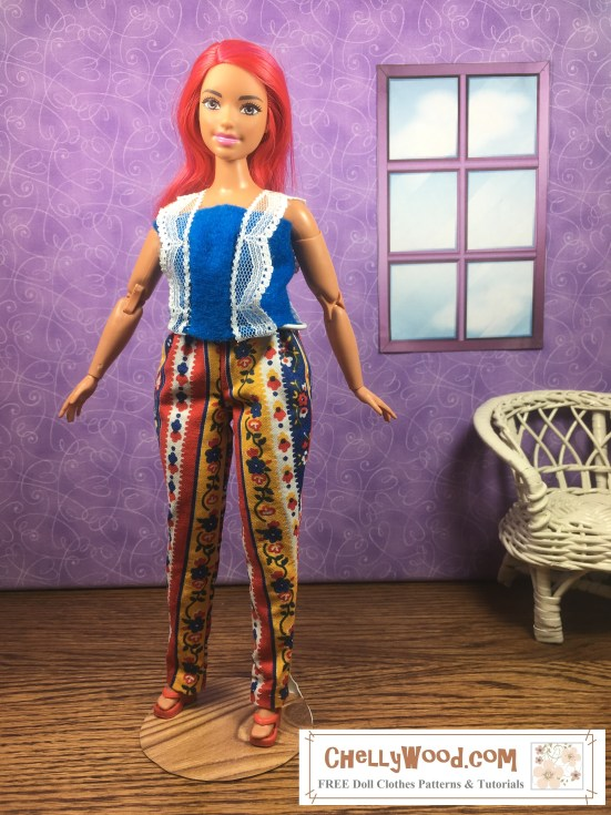Visit ChellyWood.com for FREE printable sewing patterns to fit dolls of many shapes and sizes. Image shows a Made-to-Move Curvy Barbie doll wearing a pair of handmade elastic-waist pants and a home-made felt top. She stands in a room with purple wallpaper and a wicker chair. Behind her is a window. Her pants are made of multi-colored fabric designed with stripes and flowers. The felt top she wears has straps made of lace, and the lace embellishes the front of the top as well. The doll's smiling face is framed by shockingly pink hair. The watermark on the image states: ChellyWood.com: free printable sewing patterns and tutorials. This curvy-figured made-to-move Barbie is somewhat rare and hard to find, but the doll clothes patterns from this website (the patterns used to make this outfit) will fit any Curvy Barbie doll.