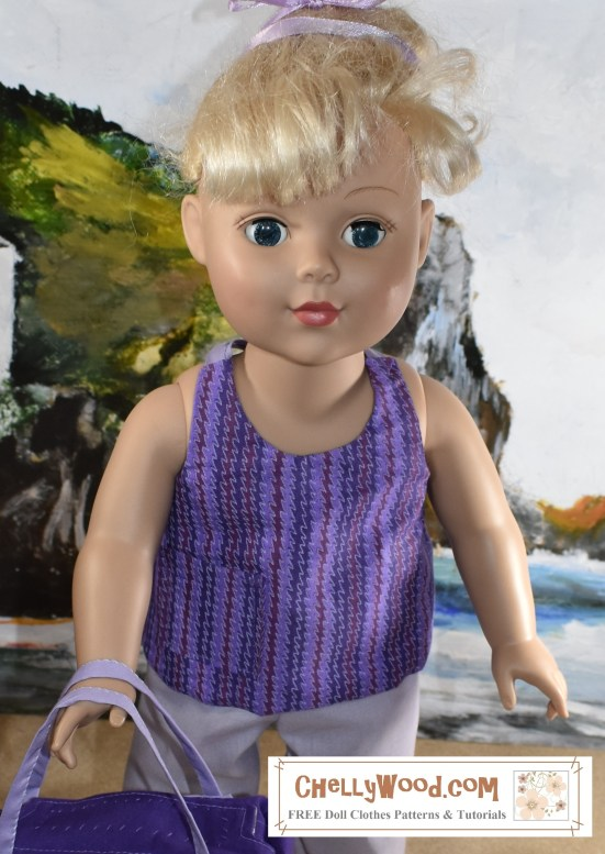 """Image shows the 18"""" or 46 cm doll from the Madame Alexander Doll company wearing a handmade halter top or tie-in-back summer shirt. In the front it looks a lot like a tank top but it's really easy to sew. The image is a close-up which highlights the features of the summer shirt including one pocket and a ribbon tie at the neck. She stands on a sandy beach with a seascape behind her including rocky cliffs and rolling waves. This 18 inch or 46 cm Madame Alexander Doll is getting ready to have some fun at the beach today. The header for the image says, """"Summer Shirt Pattern for Madame Alexander Dolls"""" and the watermark says, """"ChellyWood.com: FREE doll clothes patterns and tutorials."""" In fact, if you go to ChellyWood.com, you can download the free, printable sewing pattern for this summer tank top style shirt and the other Madame Alexander -sized doll clothes patterns for the other items of clothing, and all patterns at ChellyWood.com are free and come with a free tutorial video showing how to make the clothing item (including this summer shirt for dolls)."""