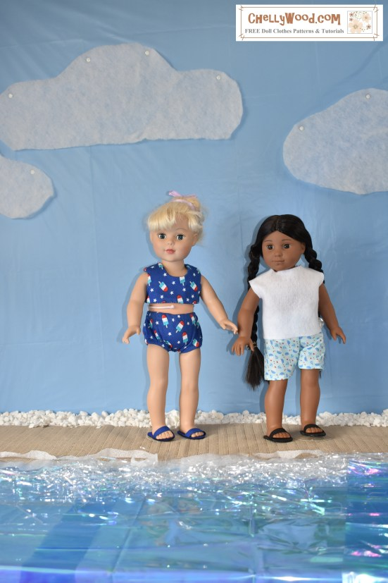 "The image shows an 18-inch American Girl doll (Kaya) and an 18 inch Madame Alexander doll playing on a beach. The beach is a home-made diorama including a table cloth-covered wall that looks like a blue sky with quilt-batting clouds overhead and vellum wrapping paper with tinsel on top to look like water on a fake-sand beach. The two dolls seem to be enjoying the sunshine as friends at the beach. The image has a watermark that says ""ChellyWood.com: free doll clothes patterns and more."" The Madame Alexander doll wears a blue bikini that has been hand-sewn. Its fabric is dotted with little popsicles. The American Girl doll wears a hand-made felt shirt with nautical-print cotton shorts (also sewn by hand). Both girls wear DIY sandals to match."