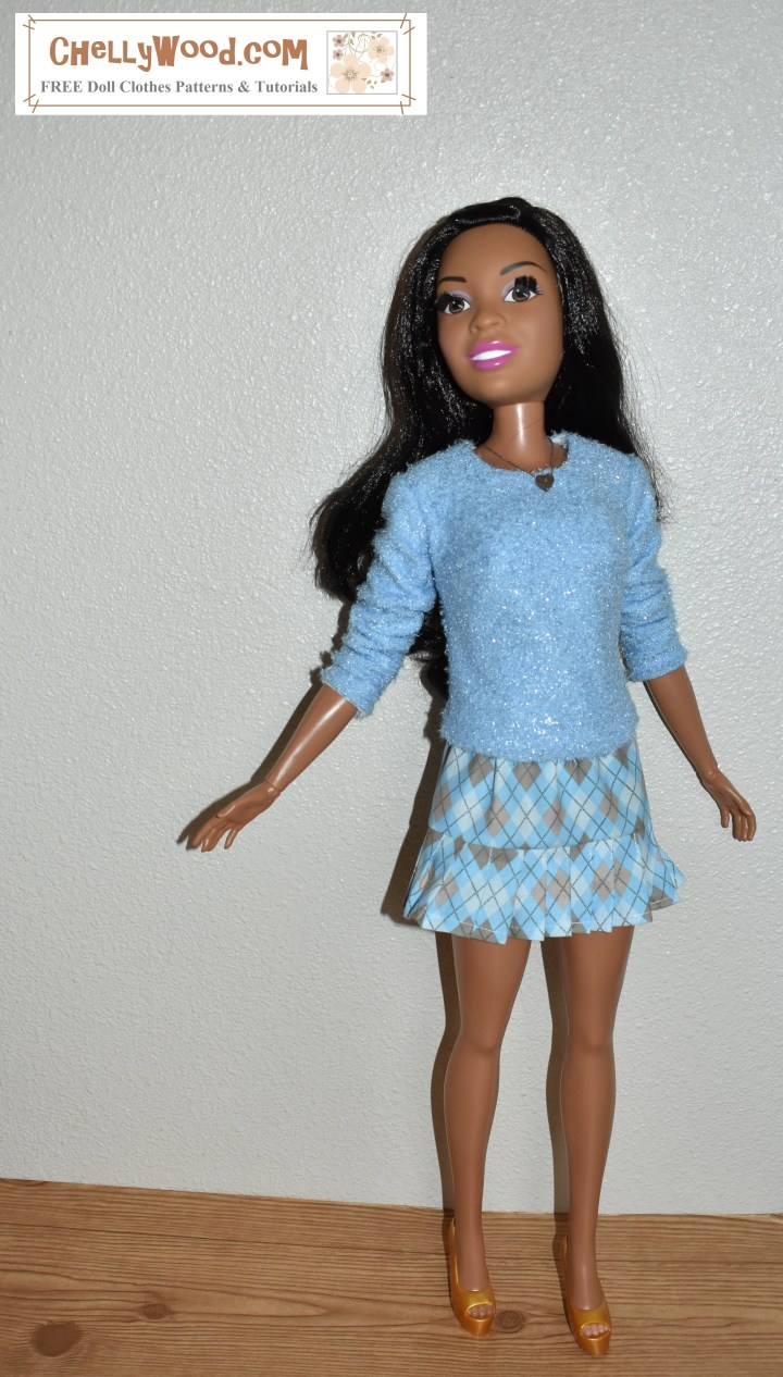 The image shows a 28-inch Fashion Friend Barbie doll wearing handmade doll clothes including an argyle skirt in blue and tan plaid, with a cashmere-style sweater. The skirt uses knife pleats in a ruffled edge around the bottom of the skirt. The overlay offers the website where you can find the free printable sewing pattern for this outfit including patterns for both the argyle skirt and the cashmere-style sweater for 28 inch fashion dolls.