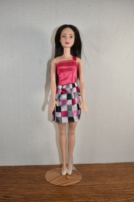 One-shoulder strappy Barbie dress made by Aleah, age....?