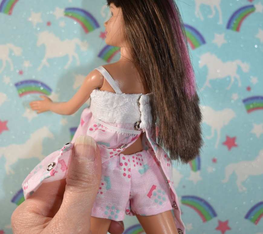 This image shows Chelly Wood (doll clothes designer) holding up a Skipper doll. She has opened up the back of Skipper's pajamas to expose the little shorts that go underneath the PJ's, and although these shorts were primarily designed to fit Barbie, we see that they also fit this modern Skipper (dated 2010). The blog post that goes with this image (found at ChellyWood.com) suggests that the old skipper from the 1960s and 1970's is different from Modern skipper, in terms of her measurements. All body measurements for the 2010 skipper are provided with the blog post.