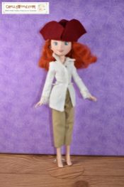 In this image, Merida wears a colonial tricorn hat, a lacy colonial blouse, and short pants.