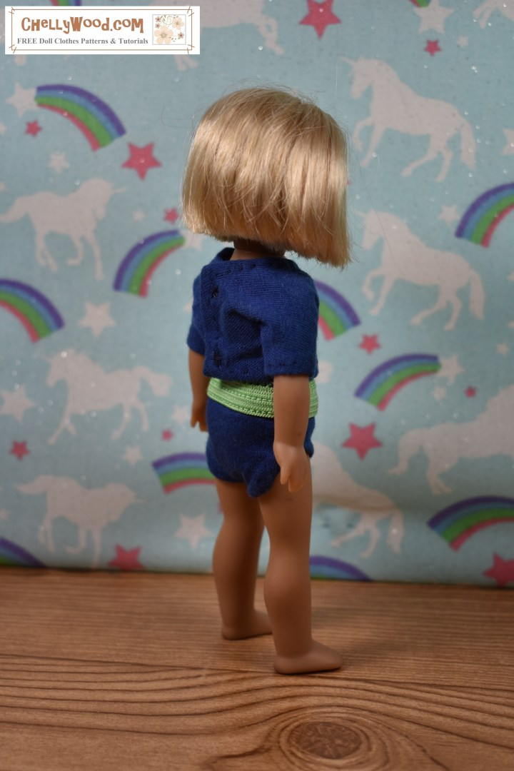 """The image shows a 6-inch American Girl doll modeling a pair of handmade briefs (underpants / knickers) with a handmade T-shirt (tee shirt). The watermark says """"ChellyWood.com"""" which is the URL of the website where you can download free printable sewing patterns for doll clothes, including this pair of underpants and this shirt pattern for 6 inch dolls like American Girl."""