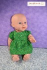 This image offers a link to a blog post where you'll find a free printable PDF pattern for sewing a doll dress and diaper to fit 12 inch (30 cm) baby dolls.