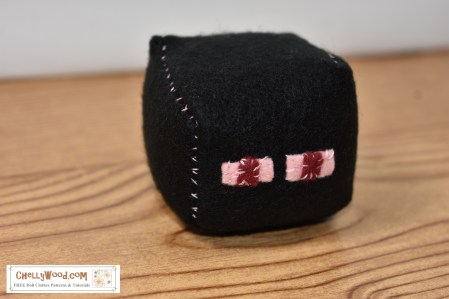 "The image shows Enderman from Minecraft. This is an easy-to-sew felt cube with a free printable PDF sewing pattern, which you can download at ChellyWood.com as a PDF file. The Enderman character is trademarked, so this is an ""unofficial"" pattern, designed by patern designer Chelly Wood. You can make this felt Enderman character or other Minecraft characters into a foot sack, hackey sack (hacky sack) or plush toy using a simple free pattern and felt. Go to ChellyWood.com for this and other fun craft projects for boys and girls to make / sew with felt."