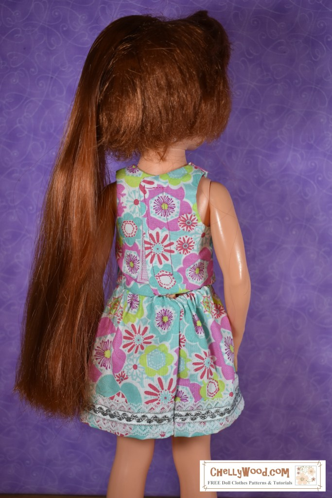 An Ideal Toy Corporation's vintage Crissy doll stands with her back to the camera. Her long red hair is pushed aside so you can see that the back of her 1970s style shirt uses a Velcro closure. This image shows the outfit you can sew for Crissy if you download the free printable sewing pattern at ChellyWood.com
