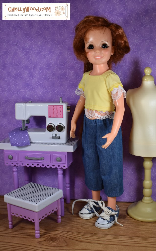 This image shows a vintage Ideal Crissy doll wearing a handmade lace-trimmed blouse and capri-length jeans. Note that the shirt fits her rather short! It's also tricky to get the shirt to close at the back, so in the accompanying blog post, it's suggested that you use snaps instead of Velcro for Crissy's shirt project, to avoid problems with the hair growing button on her back.