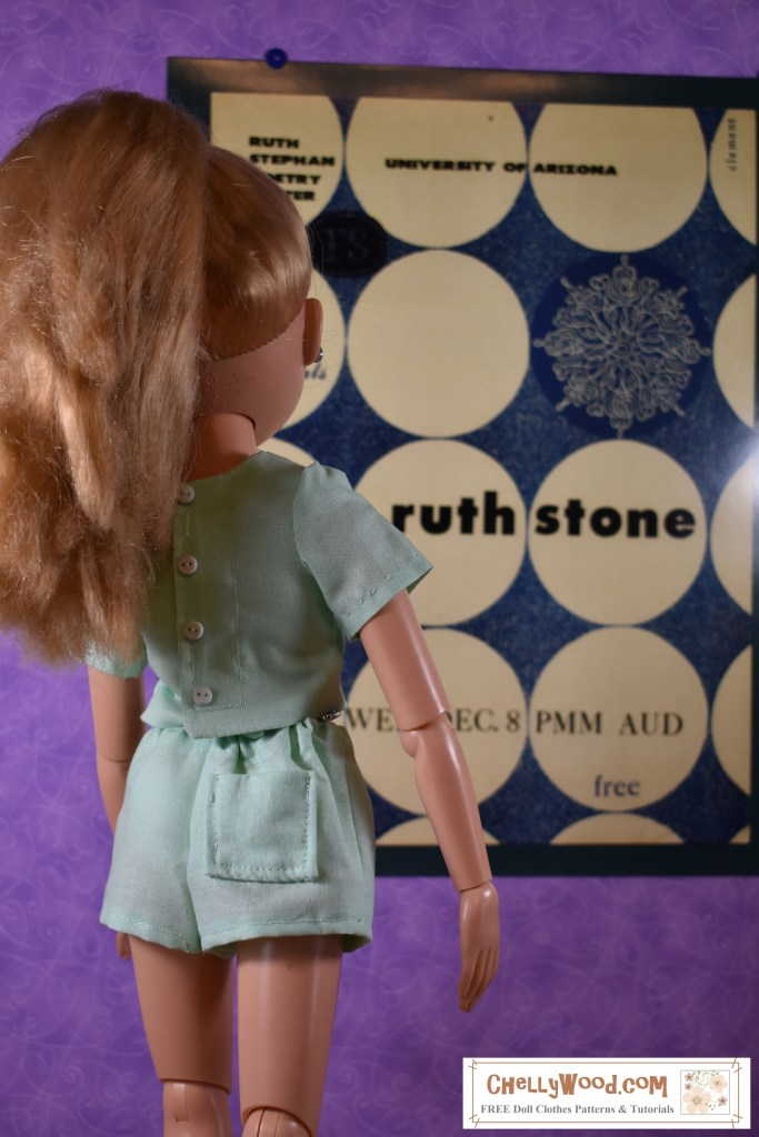 "Please visit ChellyWood.com for free printable sewing patterns to fit dolls of many shapes and sizes. The image shows an 18 inch BFC Ink doll wearing a pair of light green shorts (mint green) with a single back pocket and a cute short-sleeve shirt of matching fabric that buttons down the back. She seems to be looking at a poster on the wall of a museum, and the poster says ""Ruth Stone"" and directs people to attend a poetry reading at the University of Arizona Poetry Center. The doll looks at this retro-style poetry poster, studying its artistic value with her steady gaze."