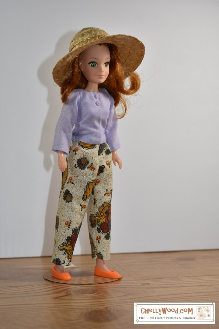 "The image shows ""Flower"" (a doll from the World of Love collection) wearing handmade doll clothes including a pair of ankle pants and a long-sleeve shirt. The free printable sewing patterns for these doll clothes are found at chellywood.com"