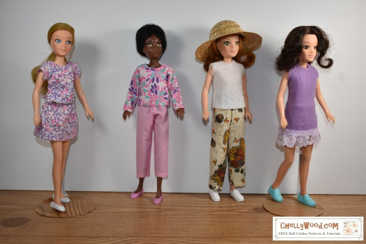This image shows four World of love dolls: Peace, Love, Soul, and Flower. Each doll wears a different outfit. Each outfit was hand sewn using the free printable PDF sewing patterns found at ChellyWood.com (where you can find free sewing patterns for dolls of many shapes and sizes).