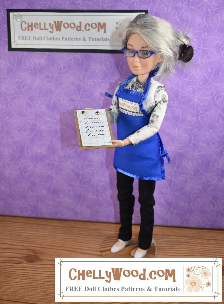The image shows the Chelly Wood doll (a Spin Master Liv doll which has been re-designed as an OOAK doll to look like Chelly Wood the doll clothing designer, blogger, and YouTuber) and she is holding up a clipboard in 1:6 scale. The clipboard has a tiny piece of graph paper on it, with scribbled writing and check marks. The Liv doll wears handmade doll clothes including pants with an elastic waist, a long-sleeve shirt, and an apron. The doll's dyed-grey hair is held up in a bun with an octopus clip. Behind her is a purple backdrop with the ChellyWood.com logo hanging on it.