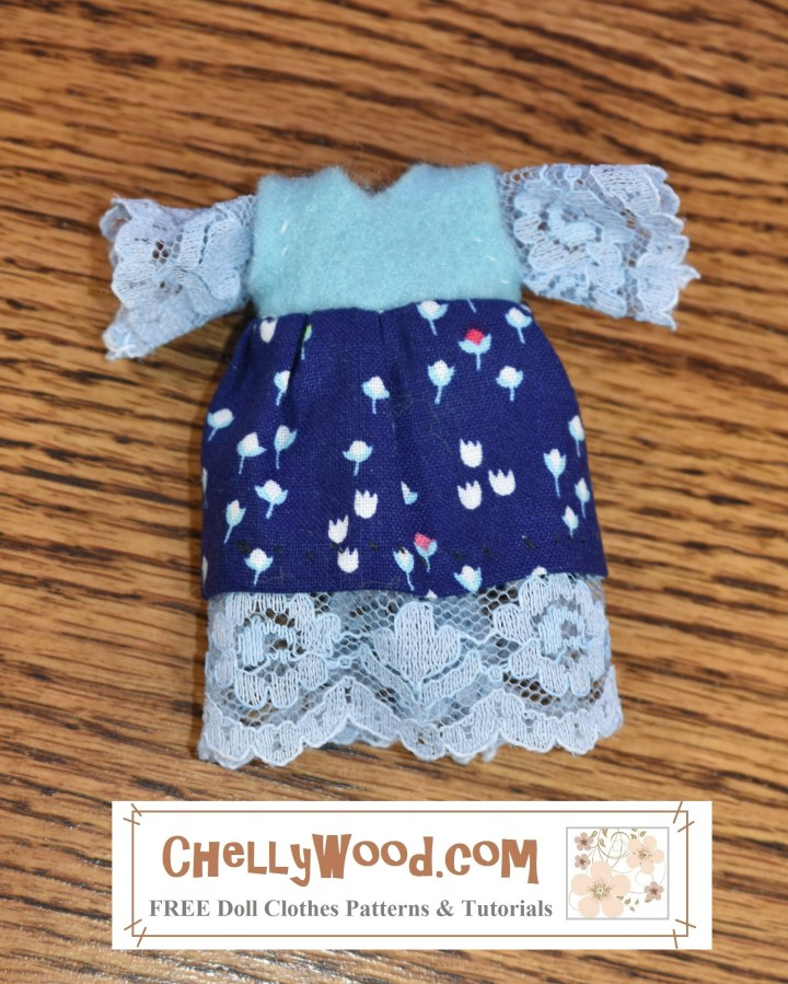 "Visit ChellyWood.com for free printable sewing patterns for making doll clothes to fit dolls of many shapes and all different sizes. This image shows a handmade tiny doll dress made of felt, cotton fabric, and lace trim. To download and print the free printable PDF sewing pattern for making this tiny dress that fits most 4-inch, 5-inch, or 6-inch dolls, please visit ChellyWood.com and go to the gallery to search for 5"" doll clothes patterns."