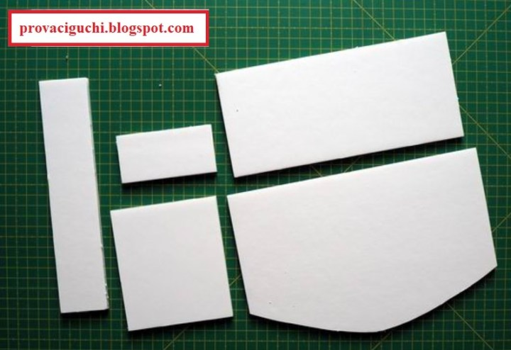 The image shows an example of the shapes one would cut out from foam board to make a 1:6 scale (Barbie doll sized) dollhouse or diorama sofa. Visit https://provaciguchi.blogspot.com/ for details on how to make a sofa for your 1:6 scale dolls and toys. Visit ChellyWood.com for free printable sewing patterns for making doll clothes to fit dolls of many shapes and sizes.