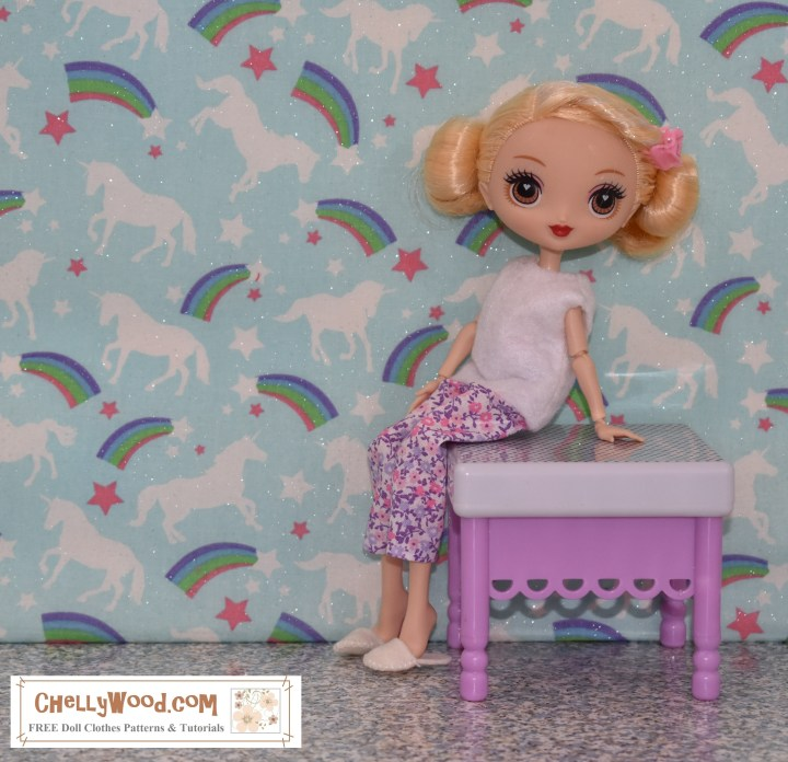 This KuuKuu Harijuku (alternate spelling of Kuu Kuu Harajuku) doll is seated on a purple and white bench. She wears a pair of handmade felt slippers, a pair of capri pajama pants (or ankle pants -- depending upon the fabric you wanted to use to make this outfit), and a white felt sleeveless shirt. The rainbow unicorn decorative wallpaper on the wall behind her reminds us of a child's bedroom. She is seated in profile with her lovely face turned toward the camera.