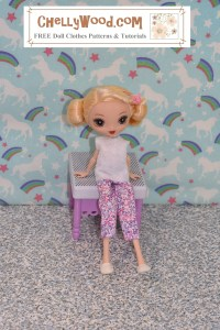 This KuuKuu Harijuku (alternate spelling of Kuu Kuu Harajuku) doll is seated on a purple and white bench. She wears a pair of handmade felt slippers, a pair of capri pajama pants (or ankle pants -- depending upon the fabric you wanted to use to make this outfit), and a white felt sleeveless shirt. The rainbow unicorn decorative wallpaper on the wall behind her reminds us of a child's bedroom. The camera angle is an overhead shot. Click on the link in the caption, and it will take you to a page where you can download and print all the free printable sewing patterns for making these doll clothes, along with links to tutorial videos that show you how to make this outfit.