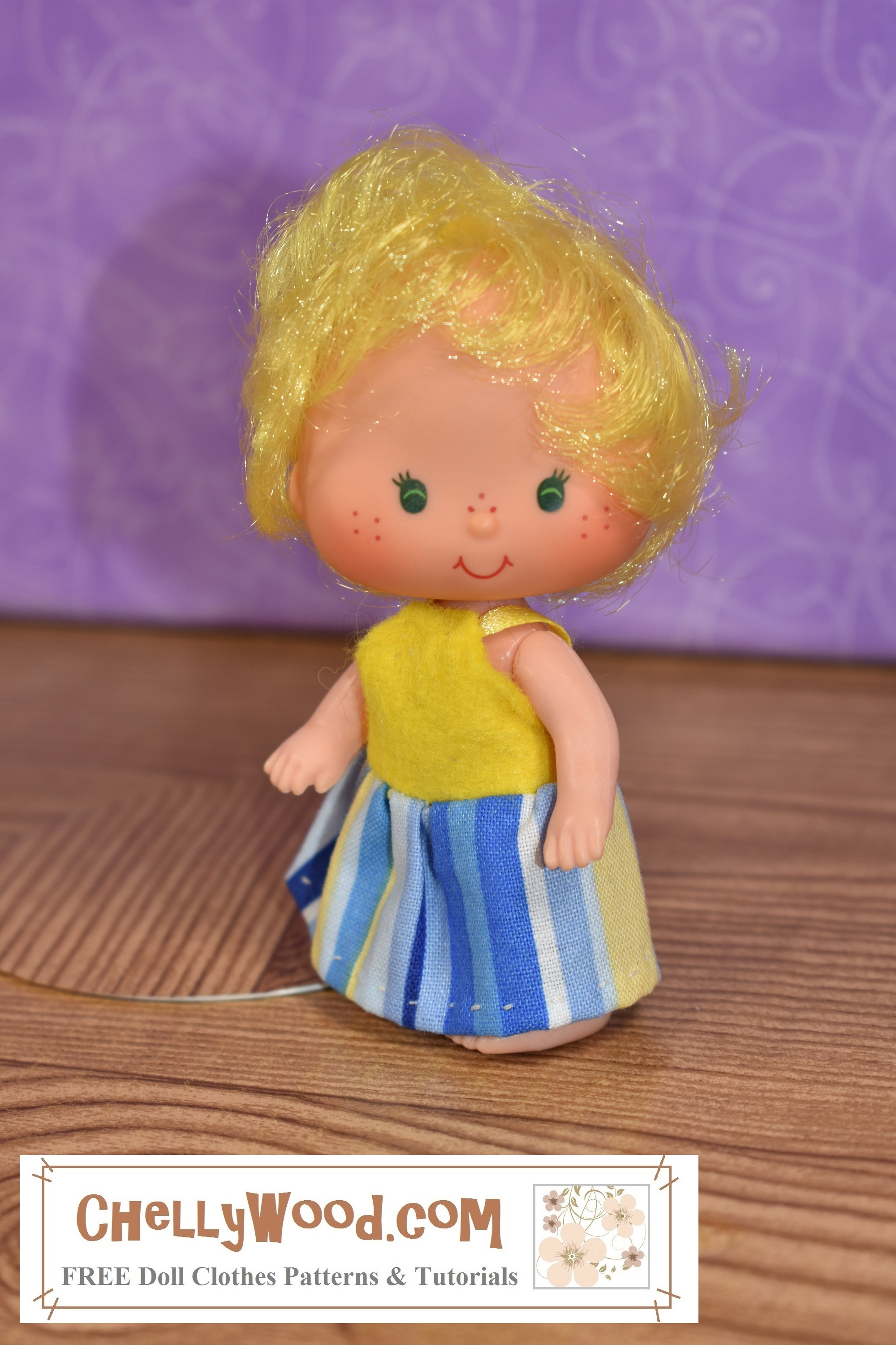 From the Strawberry Shortcake vintage dolls collection of the 1970's, here we see Butter Cream wearing a very tiny sun dress for baby-sized miniature Strawberry Shortcake dolls. (She stands 3.5 inches or 9 cm tall.) Do you have a very tiny doll you need to make some doll clothes for? Click on the link in the caption, and it will take you to a page where you can download and print all the free printable sewing patterns for making these doll clothes, along with links to tutorial videos that show you how to make this outfit.