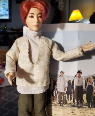 Here we see a BTS doll wearing a turtleneck sweater with a shirt that goes over it and a pair of pants. These doll clothes were made by Cindy C, using Chelly Wood's free printable sewing patterns at ChellyWood.com