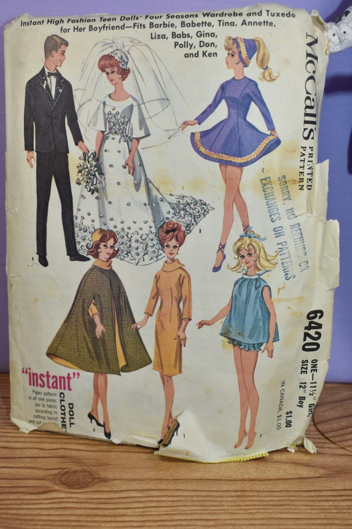 "This is a close-up image of a McCall's Barbie doll clothes pattern (number 6420, which has the copyright 1962 on the envelope. The patterns shown include a black tux with bow tie for Ken, a wedding dress with hat and veil for Barbie, a ballet or ice skating dress for Barbie (with a cone shaped hat), a pajama with bloomers for Baribe, a dress with 3/4 length sleeves and a turtle neck for Barbie, and a cape with hat for Barbie. You can learn more about this vintage Barbie pattern from McCall's by visiting ChellyWood.com and clicking on the category ""Old Patterns from Chelly's Collection"" in the list of categories on the side margin."