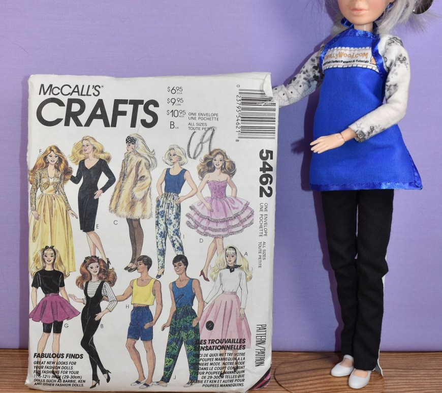 Here we see the Chelly Wood doll holding up the McCall's crafts pattern #5462, which is under discussion in this blog post.