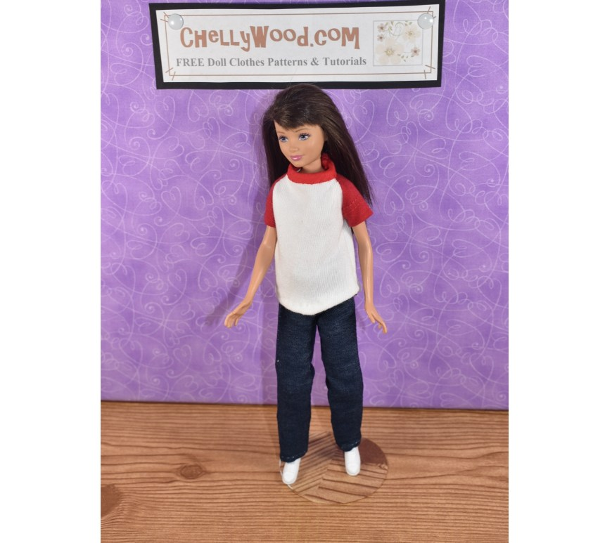 The image shows a Mattel Skipper doll wearing a handmade raglan-sleeved T-shirt with short red sleeves and a red collar. The shirt front is white. She's also wearing a pair of handmade jeans or dungarees made of lightweight stretch denim. The doll stands beneath a sign which tells the URL of the website where you can download and print the free PDF sewing patterns for making your Skipper doll clothes including this T-shirt and a pair of pants or jeans: Chelly Wood.com. Please visit ChellyWood.com for free, printable sewing patterns for making doll clothes to fit dolls of many shapes and all different sizes.