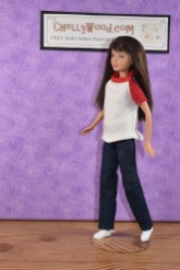 The image shows a Mattel Skipper doll wearing handmade doll clothes which were designed to fit dolls with body types like the Mattel Skipper doll. The doll clothes shown on this doll include a raglan-sleeved T-shirt and jeans. Click on the link in the caption to access all the free printable PDF sewing patterns and tutorial videos you'll need to help you make these doll clothes for your Skipper-sized dolls.