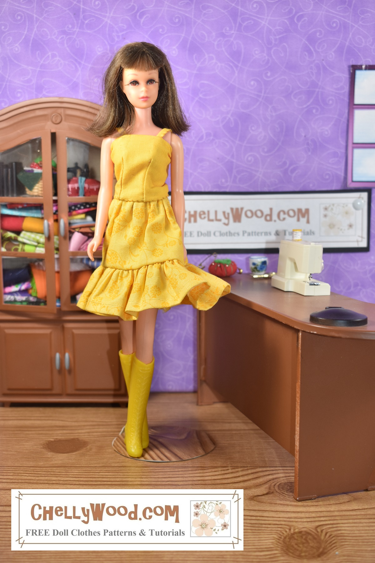 Click on the link in the caption, and it will take you to the page where the free printable PDF sewing patterns and easy-to-follow video tutorials for making these doll clothes can be found. The image shows a vintage Francie doll wearing a handmade tank top and skirt. The skirt has an elastic waist and a ruffle. The doll also wears matching butter-yellow go-go boots from the early 1970's. The doll models this lovely butter yellow doll clothes outfit in a sewing room. Behind her is a cabinet filled with fabric. At her right hand is a tiny sewing machine on a desk with a pair of scissors and a tiny tomato-shaped pin cushion. The overlay tells where you can download the free printable sewing patterns and watch the tutorial videos for making these doll clothes: ChellyWood.com