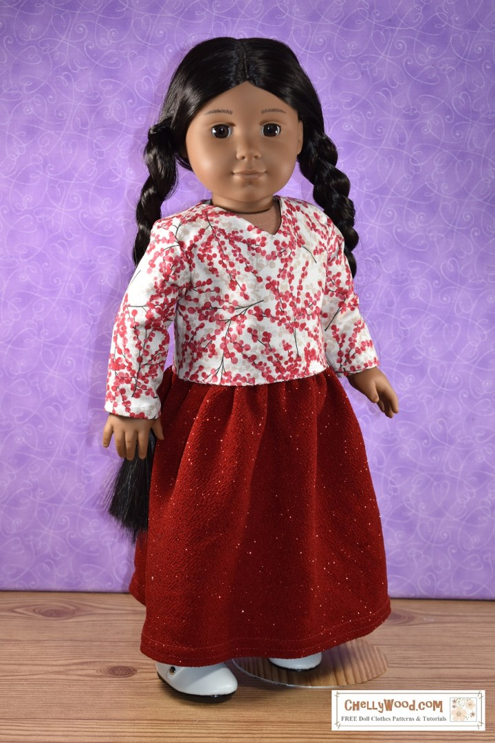 "Click on the link in the caption to navigate to the page where you can download the free printable PDF sewing patterns for making this outfit for your 18 inch dolls. The image shows an 18-inch ""Kaya"" American Girl doll, wearing handmade doll clothes that were sewn using the free printable PDF sewing patterns found at ChellyWood.com. These free 18 inch doll clothes sewing patterns included a pattern for a long holiday skirt made of glittery red fabric and a long-sleeved V-neck blouse made of winter berry red and white cotton fabric. The doll's long braided hair goes all the way down her back, looking especially elegant with her long skirt. She wears white Mary Jane ""patent leather"" style shoes. The overlaying watermark tells you to go to ChellyWood.com for your free printable PDF sewing pattern for making doll clothes for dolls of many shapes and all different sizes."