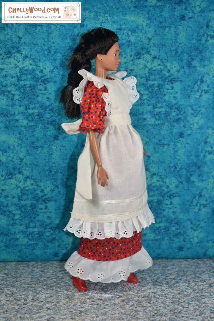 "Here we see a Mattel Barbie modeling a handmade ""pioneer-style"" dess and pinafore. Tis is a side view of the dress and pinafore. The article that this image accompanies describes how a sewist can mix and match doll clothes patterns to come up with a new look or to fill the void when a craft pattern is missing some of the pattern pieces. Please visit ChellyWood.com to learn more about mixing and matching craft patterns and/or doll clothes sewing patterns to create a complete doll wardrobe for your Barbie or other dolls. ChellyWood.com offers free printable sewing patterns for making doll clothes for dolls of many shapes and all different sizes. It also offers advice for the beginning sewist / sewer who is making doll clothes."