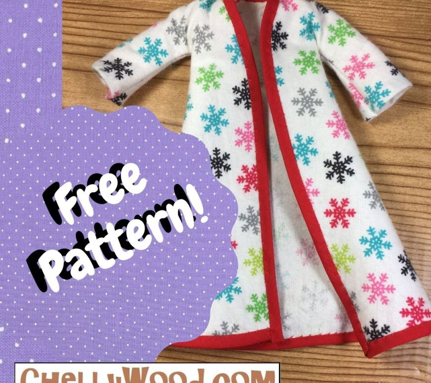 "The image shows a 1:6 scale doll bathrobe. It's made of white flannel decorated with tiny multi-colored snowflakes. The robe is trimmed in red 1/4 inch bias tape. The overlaid text says ""free pattern"" and suggests that you visit ChellyWood.com for your free printable doll clothes sewing patterns."